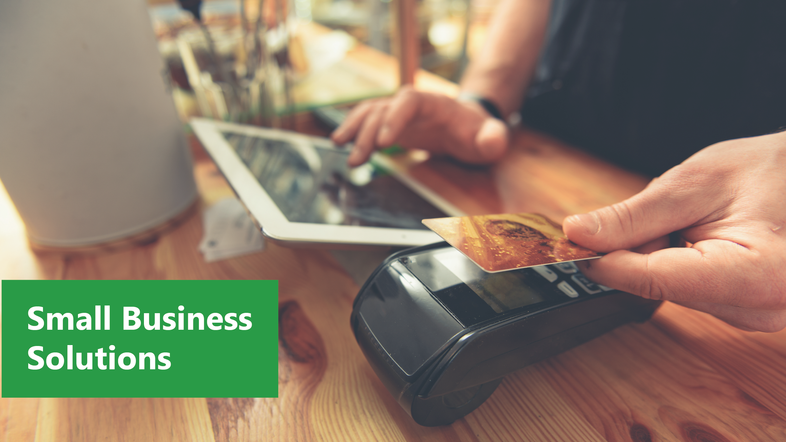 Credit Card being used in card reader at business