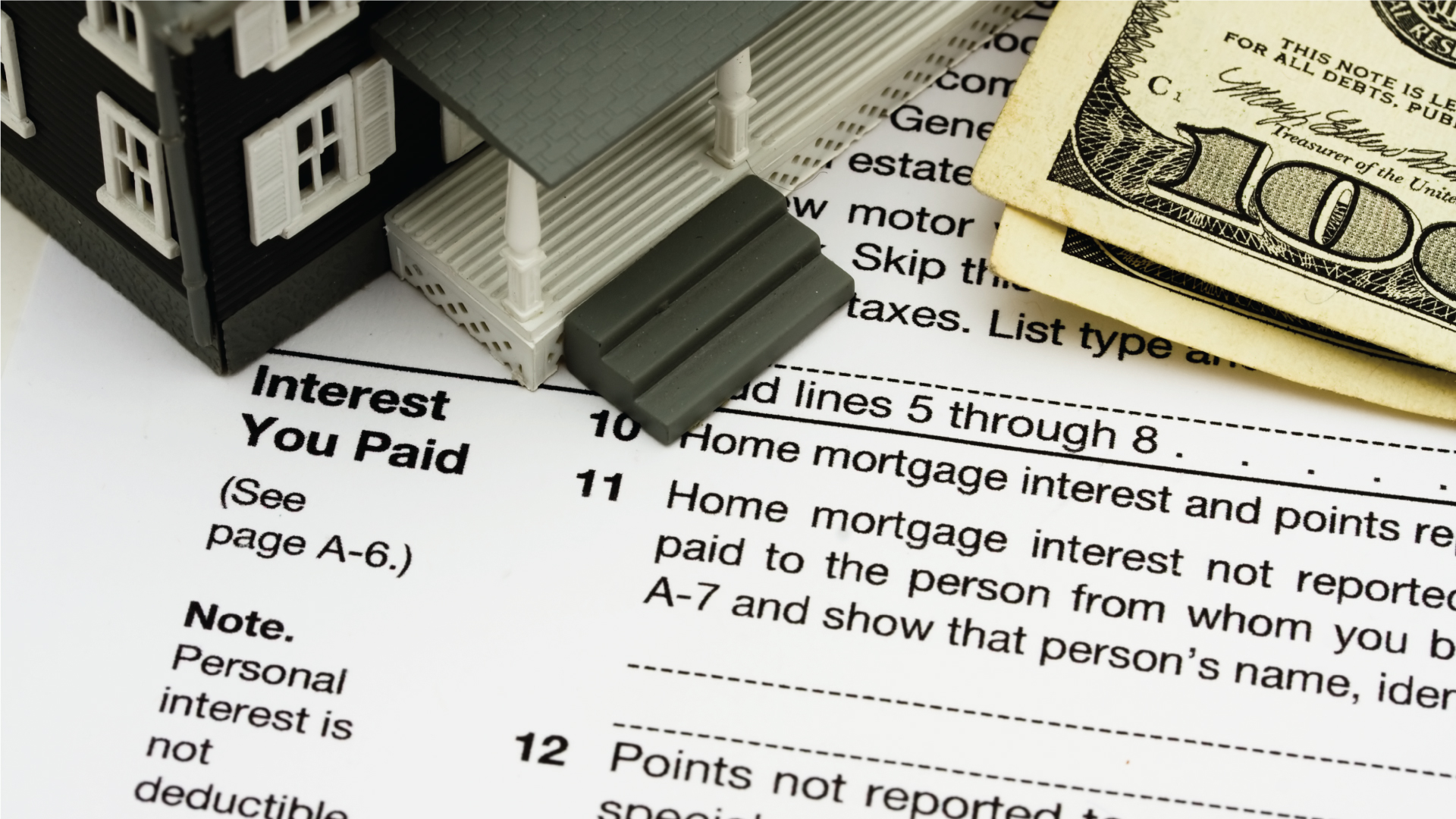 W-4 tax sheet with money and house on it