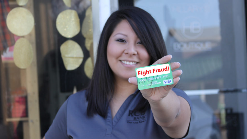 Girl holding credit card that reads fight fraud