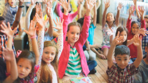 kids with hands raised